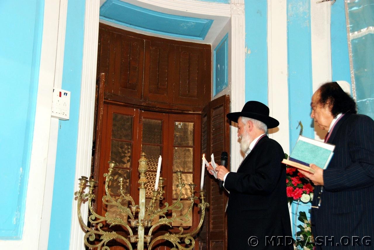 Rabbi Menashe and Solomon Sopher light Hanukkah