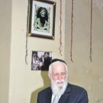 abbi Ya'aqob Menashe under portrai of Ben Ish Hai , at the Keneseth Eliyahoo Synagogue, Mumbai, India.